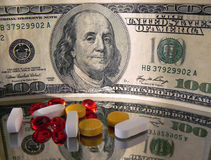 Money and Pills. Concept with American dollars and pills Royalty Free Stock Photography