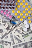 Money and pills Royalty Free Stock Photo