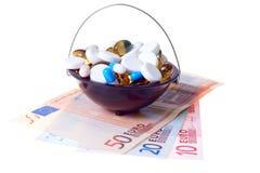 Money and pills Stock Photos
