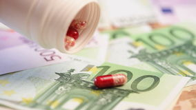 Money and pills stock footage