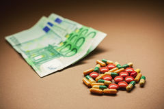 Money and Pills Stock Photography