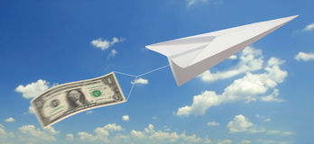 Money plane. One dollar with paper plane on sky Stock Photography