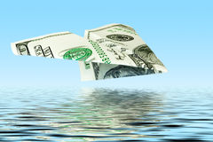 Money plane under water Royalty Free Stock Photography