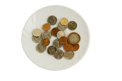 Money  plate. Money for a white plate on a white background Royalty Free Stock Images