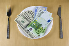 Money on the plate. This photo illustrated concepts: money for food, money instead of food, success in making money, salary Royalty Free Stock Photos