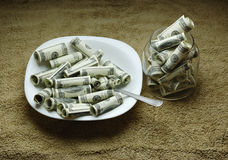 Money on the plate Stock Photography