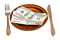 Money on the plate with fork and knife Stock Images