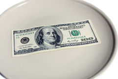 Money on plate. One hundred dollars  in plate Stock Image