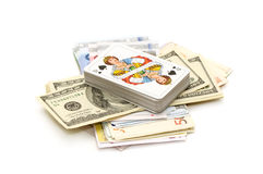 Money and playing cards Stock Image