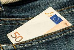 Money into the pocket Royalty Free Stock Image
