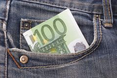 Money in the pocket. One hundred euro banknote in the jeans pocket Stock Image