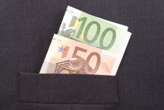 Money in the Pocket. Euro banknotes in the pocket of a dark suit Royalty Free Stock Photography