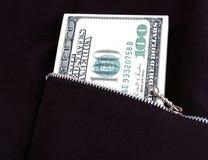 Money in pocket. Bill 100 dollars pocket with lock-zipper Royalty Free Stock Photography