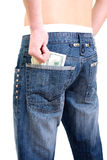 Money in pocket. American money in blue jeans pocket royalty free stock images