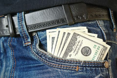 The money is in the pocket of blue jeans Stock Images
