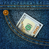 Money in the pocket of blue jeans Royalty Free Stock Photos