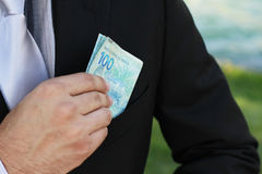 Money on pocket Stock Images