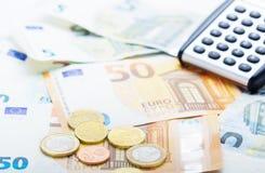 Money, pocket calculator stock photo