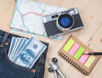 Money in pocket jean ,camera and map Royalty Free Stock Photo