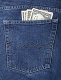 Money in a pocket of jeans. Some dollars in a pocket of jeans stock images