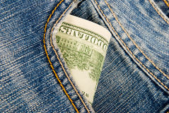 Money in a pocket of jeans Royalty Free Stock Photo
