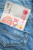 Money in pocket of jeans Royalty Free Stock Image
