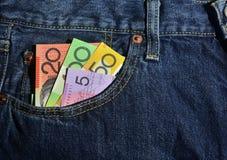 Money in the Pocket of New Jeans. Australian money in the front pocket of a pair of jeans, $100, $50, $20 and $5.00 notes. Copyspace Stock Image