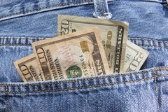 Money in Pocket. A wad of dollars in the back pocket of some jeans Royalty Free Stock Photography