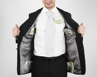 Money in pockets. Young man in suit that carry money (100s of dollar and euro) in his pockets Stock Image