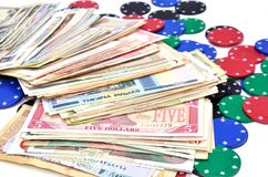 Money and poker chips Stock Photography