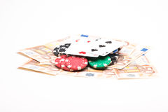 Money with poker chips and cards Royalty Free Stock Images