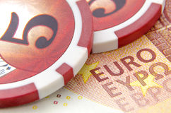 Money with poker chips. Euro with red poker chips. Macro photo. Depth of field Royalty Free Stock Photography