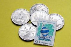 Money and postage stamp Stock Photo