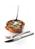 Money in the pot. And cutlery. white background Royalty Free Stock Images