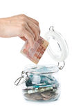 Money in a pot. Stock Images