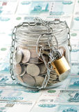 Money in a pot. Stock Photos