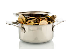 Money pot. A cooking pot is well filled with euro coins, symbolic photo for funding Royalty Free Stock Photo