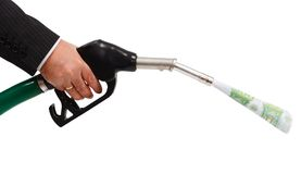 Money pouring from gas nozzle Royalty Free Stock Photo