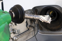 Money pouring out of gas pump Stock Photography