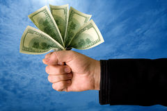 Money Power. A metaphorical image of a powerful businessman showing his cash Royalty Free Stock Photography