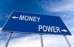 Money or power. Billboard and blue sky Stock Photo