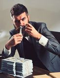 Money and power. Business and finance. Bearded man count dollars while smoking cigar. Successful businessman hold cash stock photos