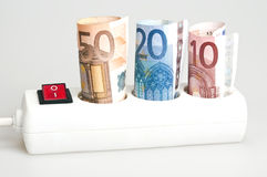 Money on power outlet royalty free stock photography