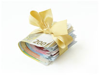Money present. Stack of money - Euro banknotes - wrapped with a golden ribbon and bow, isolated on white background Royalty Free Stock Images