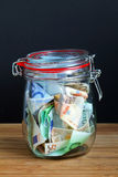 Money in the preserving jar Royalty Free Stock Photography