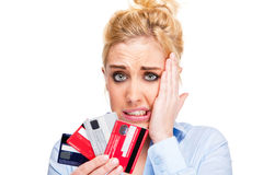 Money Problems Stressed Woman Holding Credit Cards. Money and Debt Worries - Close-up of Attractive Young Woman Holding Credit Cards Isolated Against White Royalty Free Stock Photography