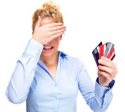 Money Problems Stressed Woman Holding Credit Cards. Money and Debt Worries - Close-up of Attractive Young Woman Holding Credit Cards Isolated Against White Stock Images
