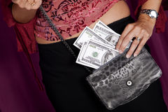 Money on the purse. Lots of money on the purse Royalty Free Stock Photography