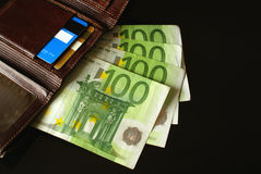Money purse. With one hundred Euro notes, credit card and debit card Royalty Free Stock Images