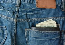 Money with purse in back pocket Royalty Free Stock Image